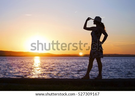 Happy healthy woman standing on the beach