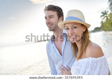 https://thumb10.shutterstock.com/display_pic_with_logo/624661/357695393/stock-photo-happy-just-married-couple-walking-on-a-sandy-beach-357695393.jpg