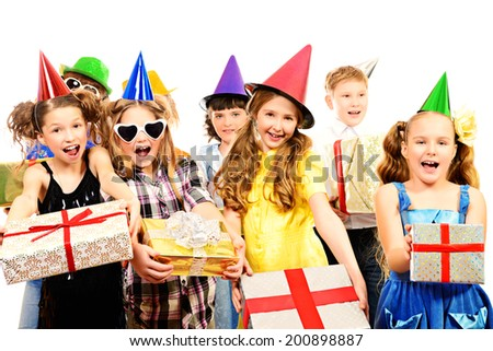 Happy kids having fun at a party. Holidays. Gifts. Isolated over white.