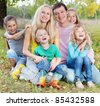 Happy large family with children in autumn park - stock photo