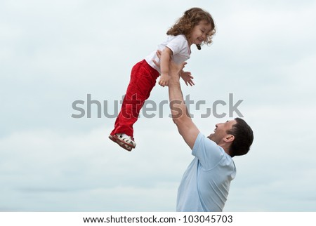 Happy little asian girl enjoying time with her daddy