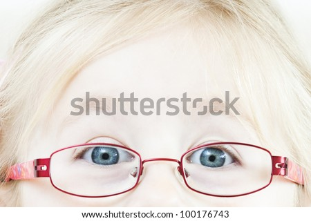 Happy little blond girl with glasses
