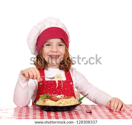 happy little girl cook eat spaghetti