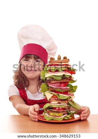 happy little girl cook with big sandwich