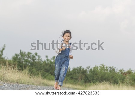 happy little girl on road