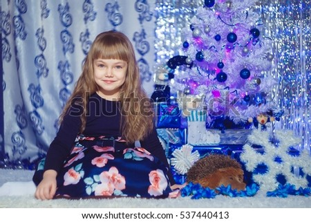 Happy little girl with christmas gift box