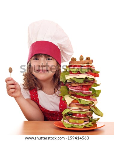 happy little girl with olive and tall sandwich