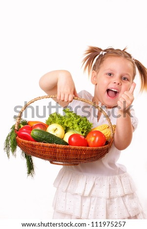 Happy little girl with vegetables and fruits