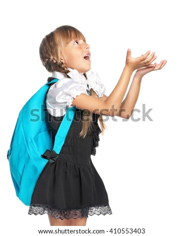 Happy little schoolgirl with hands up isolated on white background