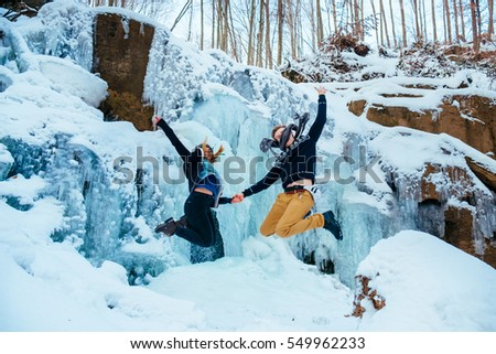 happy loving couple walking in snowy winter forest, Outdoor seasonal activities. Lifestyle capture.