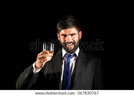 Happy man with a glass of whiskey in his hand,celebrating