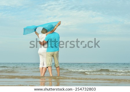 Happy Mature couple enjoy fresh air on beach