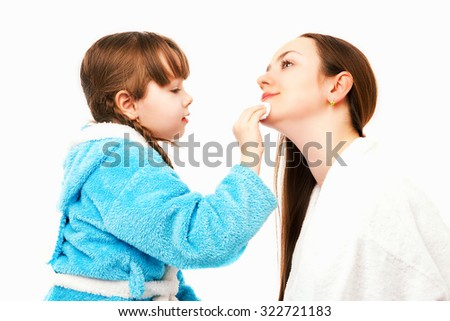 happy mother and daughter at home, daughter doing makeup to her mom, isolated against white background