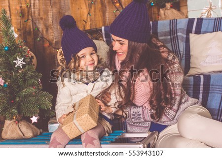 Happy mother and daughter at home, xmas concept