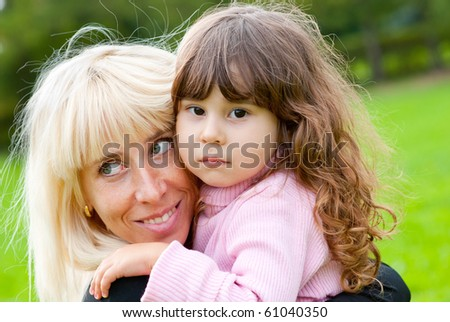Happy mother and daughter in a park