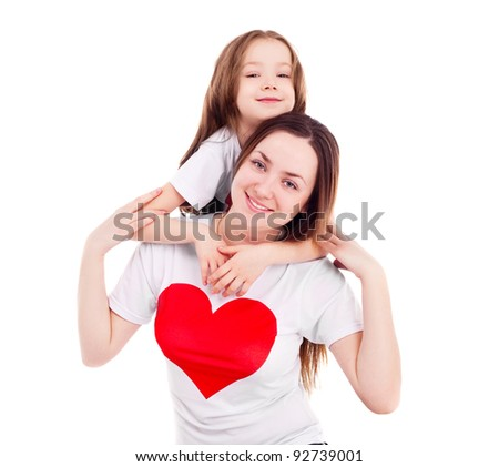 happy mother and her six year old daughter wearing T-shirts with big red hearts, isolated against white background