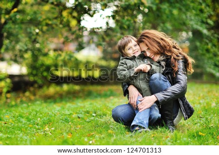 Happy mother and son portrait outdoors