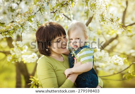 happy mother with a boy in the park