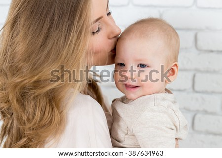 Happy mother with baby child