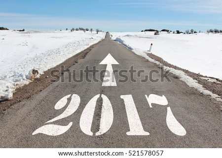 happy new year concept of snowy road heading to 2017