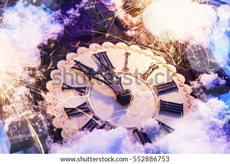 Happy new year eve celebration with old clock showing 12 in the midnight and festive fireworks