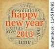 Happy new year 2013 greeting card in tag cloud on old paper - stock photo