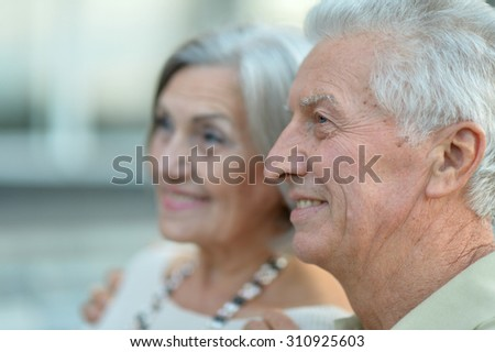 Happy nice mature couple walking in town