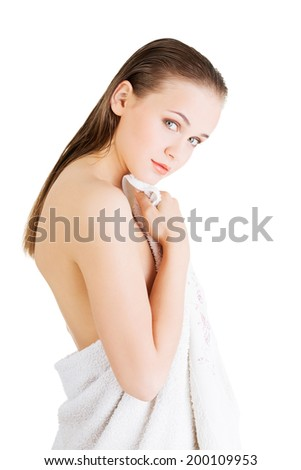 Happy nude woman with perfect body posing with white towel.