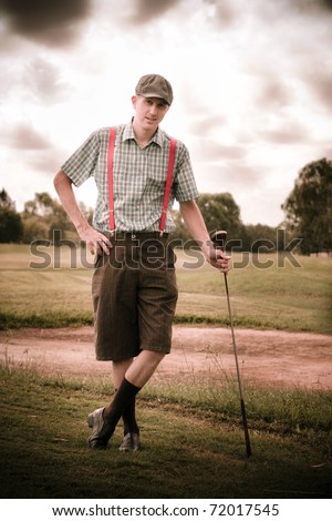 Happy Old Fashioned Golfer Leans On His Vintage Golf Stick In Front Of A Sand Bunker On A Golfing Fairway In An Olden Day Portait
