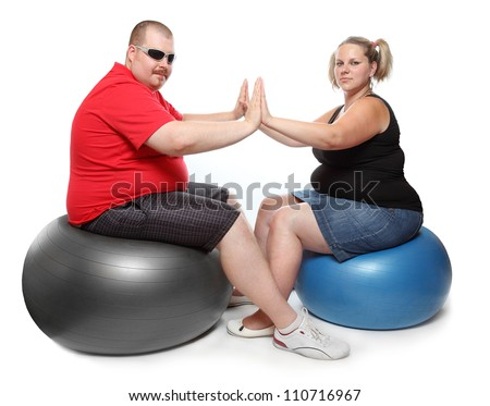 Happy overweight couple. Weight loss concept.