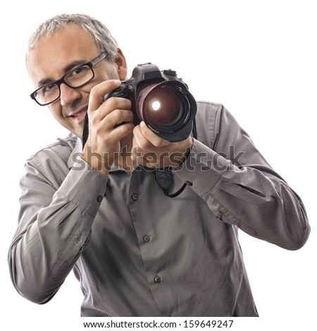 Happy photographer with professional camera smiling on white