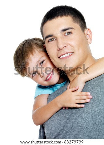 Happy portrait of the father and son of six years. Isolated on white