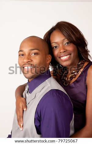 Happy, romantic, black couple hugging and smiling with affection and pleasure