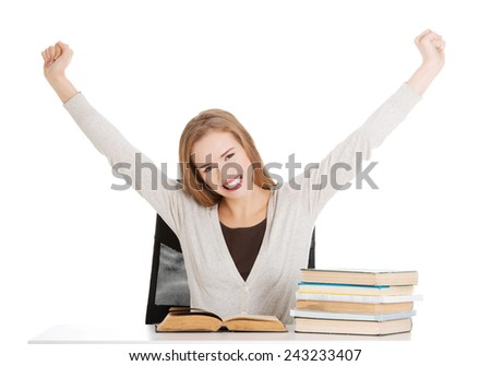 Happy, satisfied young student woman with stack of books. isolated on white.