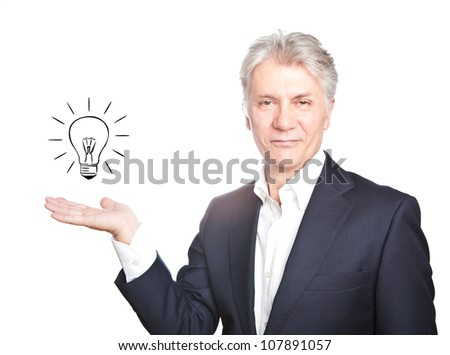 Happy senior businessman with hand gesture showing copy space on white background