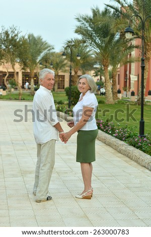 Happy senior couple at tropic hotel resort