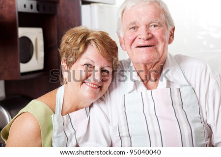 happy senior couple portrait in home kitchen