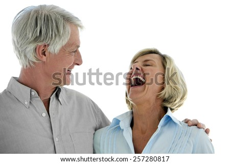 Happy senior couple - woman laughing - isolated