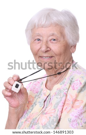Happy Senior woman wearing a medical emergency panic button pendant