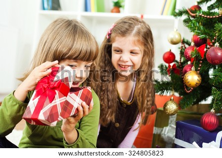 Happy sisters opening their new year's presents