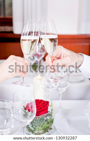 happy smiling couple in restaurant celebrate toast champagne dinner