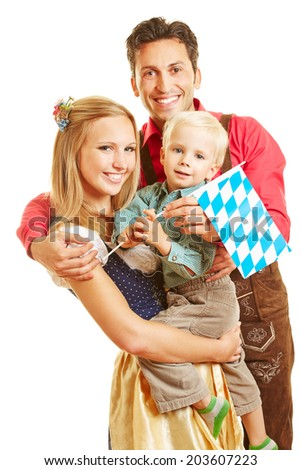 Happy smiling family in Germany with son and bavarian flag