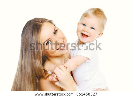 Happy smiling mother and baby having fun together on white background