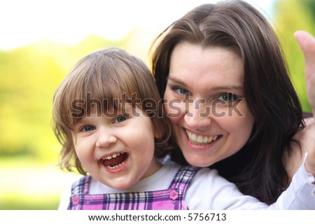 Happy smiling mother and daughter