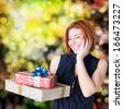 Happy smiling red-haired woman with boxes gifts.Holiday concept - stock photo