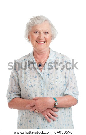 Happy smiling retired senior woman looking at camera isolated on white background