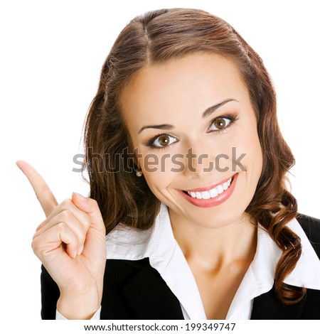 Happy smiling young business woman showing blank area for sign or copyspase, isolated on white background