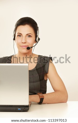 Happy smiling young woman call center operator