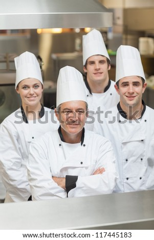 Happy team of Chef's standing in kitchen