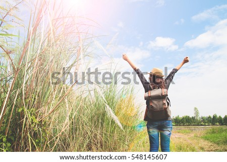 Happy traveler looking to blue sky and push hands up, Happiness life concept, space for text